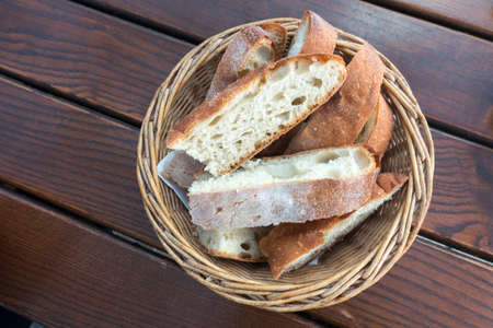basket of slice bread on wooden table