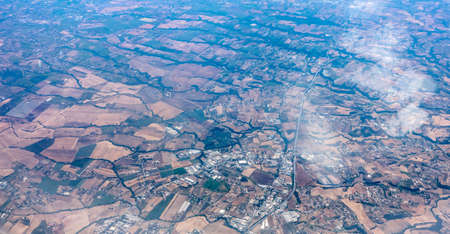 Aerial photograph area on agriculture and village as seen through window of an aircraft