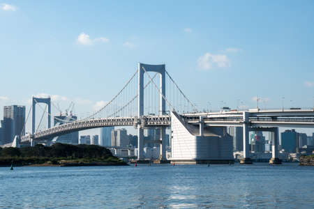 Tokyo Tower skyline and Rainbow Bridge with cityscape at Odaiba Stock Photo