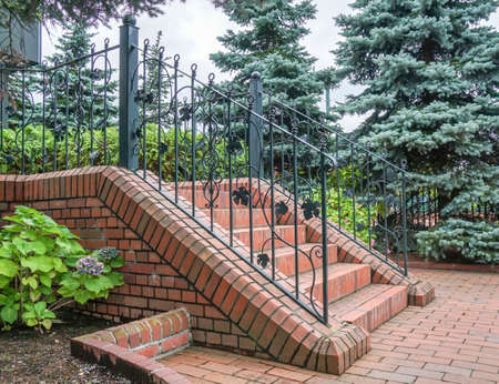 Classic Cement stairs with Ornate handrail of wrought iron Stock Photo