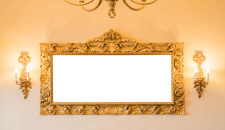 vintgage gold frame decorated on wall in hotel Stock Photo