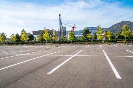 Empty space parking lot outdoor in public park.