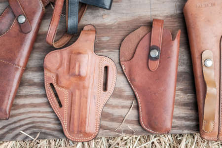 collection of Old holster on wooden background