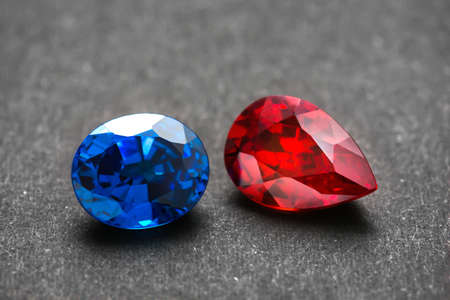Red and blue gems on black background