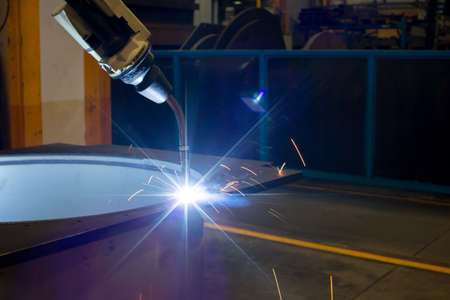 Welding robots movement in factory close up Stock Photo