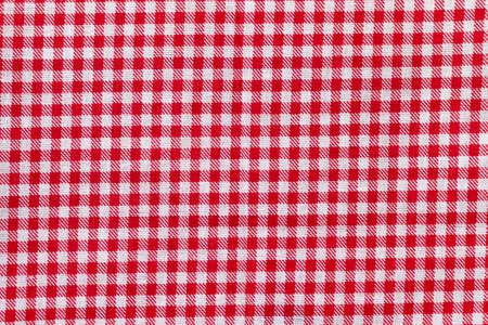 Red and white checkered fabric texture. Bright colored cotton background Foto de archivo