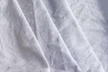 Diagonal textural background of natural linen fabric. Rough crumpled burlap texture 版權商用圖片
