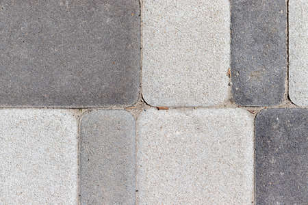 Street concrete floor tiles background texture in different shades of gray