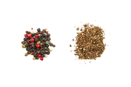 Two piles of pepper mix: grain and ground. A mix of four types of pepper grain: black, white, pink, green. Closeup top view. Isolated on white background 스톡 콘텐츠