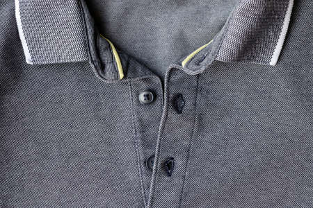 Jersey cotton fabric t-shirt with open collar and buttons texture. Gray textile polo background Standard-Bild