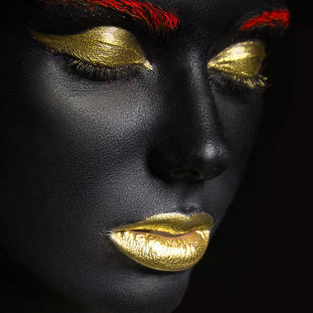 beautiful nude women: fashion portrait of a dark-skinned girl with color make-up.Beauty face. Picture taken in the studio on a black background.
