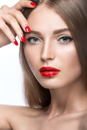 Beautiful young girl with a bright make-up and red nails. Picture taken in the studio on a white background. Stok Fotoğraf
