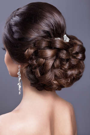 Portrait of a beautiful  woman in image of the bride. Picture taken in the studio on a black background. Beauty hair. Hairstyle back view Stok Fotoğraf - 42995855