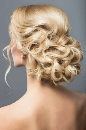 ginger hair: Portrait of a beautiful  woman in image of the bride. Picture taken in the studio on a black background. Beauty hair. Hairstyle back view