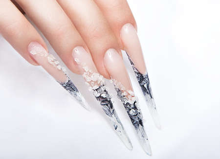human fingernail: Human fingers with long fingernail and beautiful manicure over gray.Nail art design