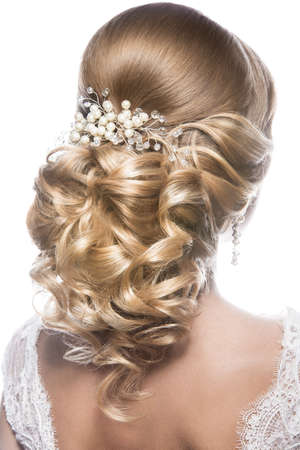photo of accessories: Portrait of a beautiful  woman in image of the bride. Picture taken in the studio on a black background. Beauty hair. Hairstyle back view