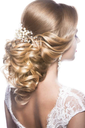 Portrait of a beautiful  woman in image of the bride. Picture taken in the studio on a black background. Beauty hair. Hairstyle back view Stok Fotoğraf - 43083859