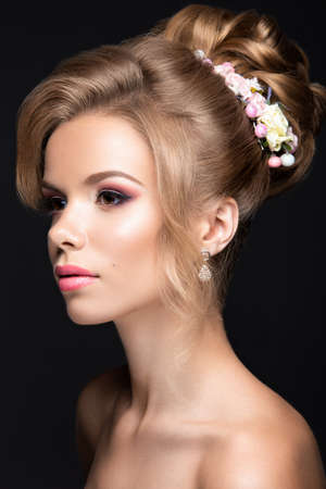hairstyle: Portrait of a beautiful blond woman in the image of the bride. Picture taken in the studio on a black background. Beauty face and Hairstyle Stock Photo