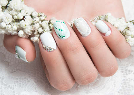 artificial nails: Wedding manicure for the bride in gentle tones with flowers. Nail Design.