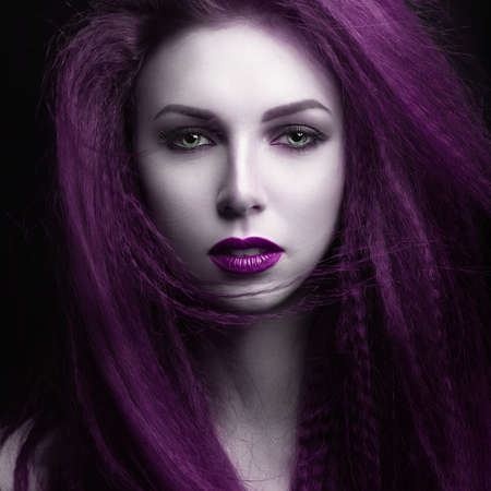 The girl with pale skin and purple hair in the form of a vampire. Insta color. Picture taken in the studio Stockfoto
