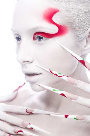 Art fashion girl with long color nails, white skin and red paint on the face. Creative art beauty. Picture taken in the studio on a white background.