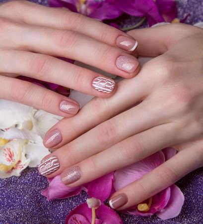 short order: Snow White manicure on female hands. Winter nail design. Picture taken in the studio