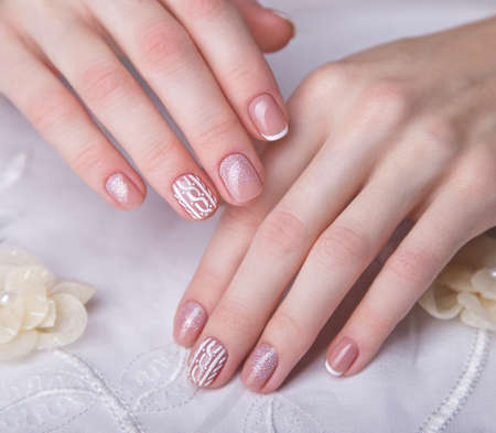 Snow White manicure on female hands. Winter nail design. Picture taken in the studio