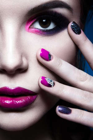 Beautiful girl with bright creative fashion makeup and colorful nail polish. Art beauty design. Beauty face. Studio portrait Stok Fotoğraf - 50898995