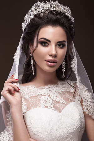 nude bride: Beautiful brunette girl in the image of the Arab bride in a wedding dress and a crown on her head. Beauty face. Picture taken in the studio