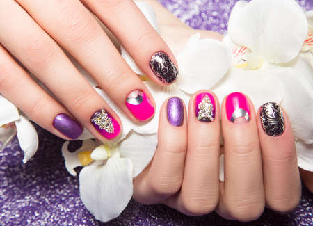 short order: Beautiful colorful manicure with bubbles and crystals on female hand. Close-up. Picture taken in the studio