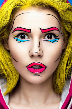 parody: Photo of surprised young woman  with professional comic pop art make-up. Creative beauty style. Photos shot in studio Stock Photo
