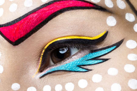 creative shot: Photo of young woman  with professional comic pop art make-up. Creative beauty style. Photos shot in studio. Close up