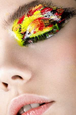 Colorful make-up on close-up eye. Art beauty image