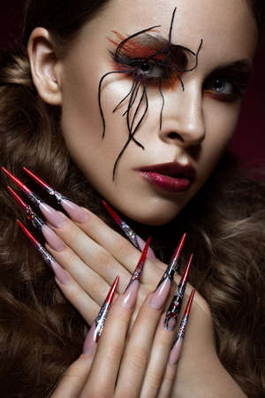 Portrait of woman in the image of spider with creative art makeup and long nails. Manicure design, beauty face. Photos shot in studio Stok Fotoğraf