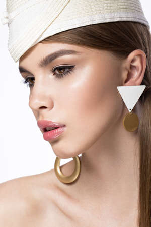 twiggy: Pretty fresh girl in the image of modern Twiggy in fashionable white hat, with unusual eyelashes and accessories. Photos shot in studio