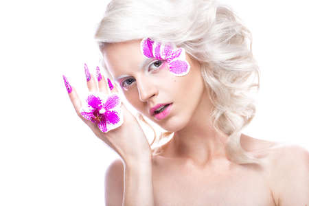 long nose: Beautiful girl with art make-up, flowers, curls and long nails. Manicure design. The beauty of the face. Photos shot in studio