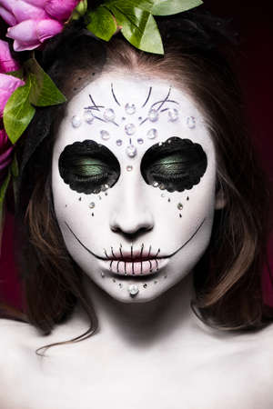 Woman in Halloween makeup - mexican Santa Muerte mask. Photos shot in studio