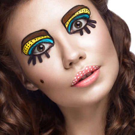 creative shot: Photo of surprised young woman with professional comic pop art make-up and design manicure. Creative beauty style and nails. Photos shot in studio