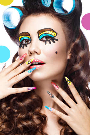 parody: Photo of surprised young woman with professional comic pop art make-up and design manicure. Creative beauty style and nails. Photos shot in studio