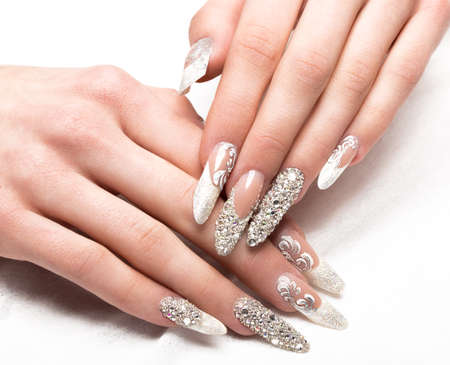 Beautifil wedding manicure for the bride in gentle tones with rhinestone. Nail Design. Close-up. Stock Photo