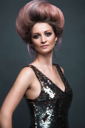 Beautiful girl in evening dress with avant-garde hairstyles. Beauty the face. Photos shot in the studio. Stock Photo