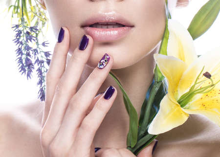 Beautiful girl with flowers, and design nails manicure. beauty face. Photos shot in studio. Close up