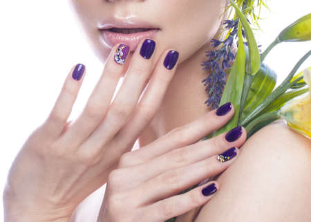 Beautiful girl with flowers, and design nails manicure. beauty face. Photos shot in studio. Close up Stok Fotoğraf - 71665979