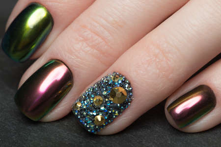 Beautifil Colorful manicure with rhinestone. Nail Design. Close-up.