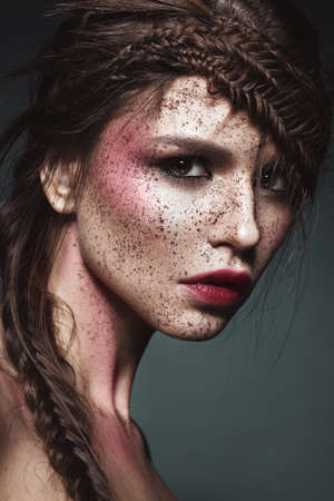 careless: Beautiful strange girl with creative art make-up. Beauty face. Photo taken in studio