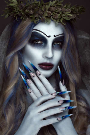 portrait of a horrible scary corpse bride in wreath with dead flowers halloween makeup and