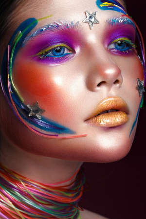 Beautiful girl with creative make-up in pop art style. Beauty face. Photo taken in studio Stock Photo