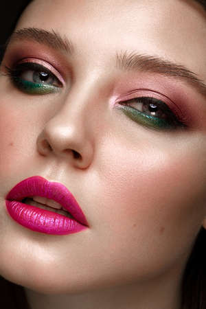 Beautiful girl with creative colorful make up. Beauty face. Photos shot in studio Reklamní fotografie
