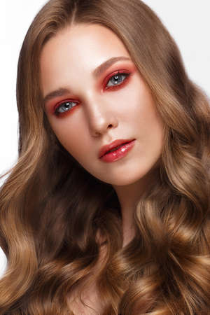 Beautiful fresh girl with perfect skin, bright red make-up. Beauty face. Photo taken in the studio. Stockfoto