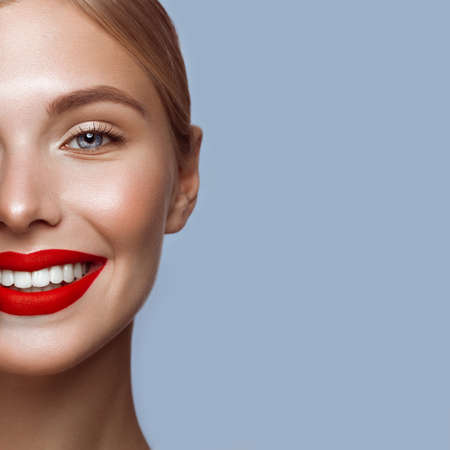 Beautiful girl with red lips and classic makeup. Beauty face. Photo taken in the studio.